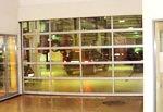 Промышленные секционные ворота. Секционные прозрачные ворота Смайл Гейт.